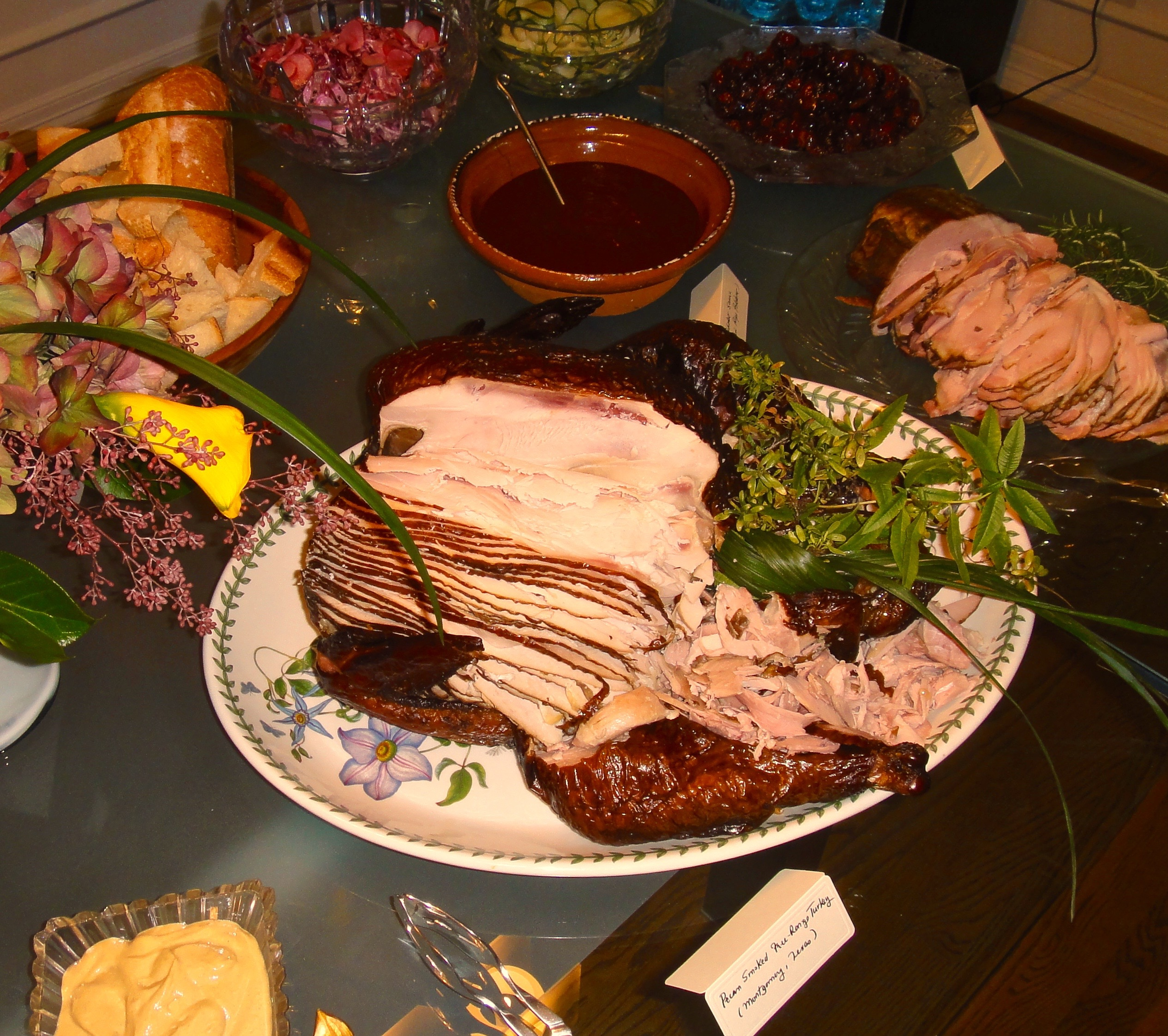 Sliced smoked turkey for Thanksgiving served with a Chile Ancho Adobo (bowl)