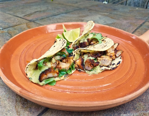 Tacos Al Pastor with rich, rustic avocado and roasted serrano salsa